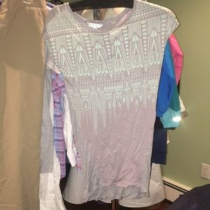 A gray and turquoise Cabi shirt.